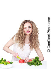 Woman making salad in kitchen Healthy eating lifestyle...