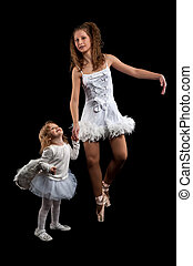Woman and little girl ballerina ballet dancer