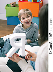 This is so much fun! - Shot of a speech therapist and a...
