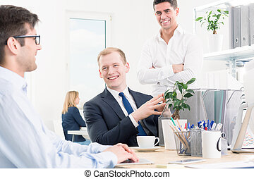 Young men full of new ideas - Happy businesspeople smiling,...