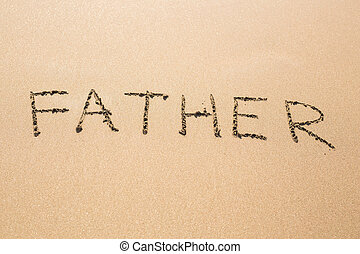 Father hand written in the sandy beach