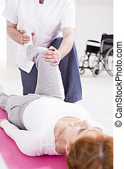 Rehabilitation after spinal cord injury - Elderly woman...