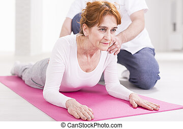 Elderly woman and spine stretching - Elderly woman after...