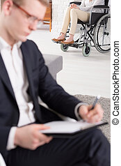 Patient on wheelchair at psychotherapist - Female patient on...