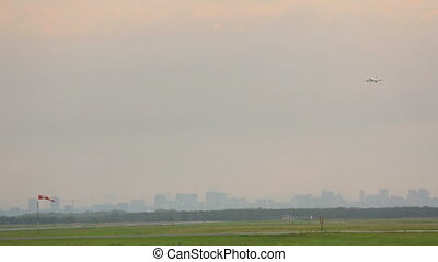 Airplane landing, city skyline - Airbus 320 approaching...