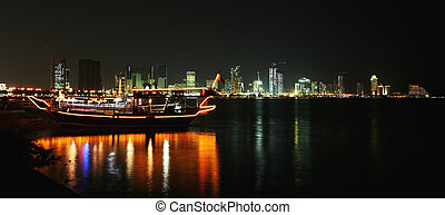 Doha corniche at night - A night view of the dhows and...