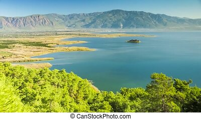 Zoom view of an island with ruins of castle in the river's valley. Dalyan, Turkey. 4k