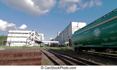 Train with Cargo Carriages in Industry Plant - Train with...
