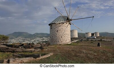 Row of windmill towers on the top of the hill 4k - Row of...