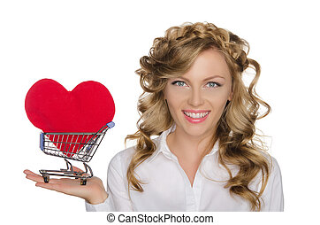 European woman with heart in shopping cart isolated on white