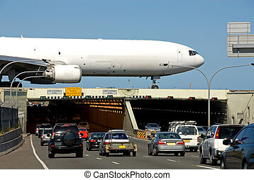 Over the Top - Traffic travelling under an airport runway,...