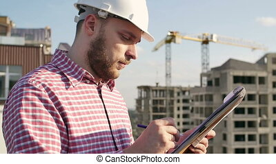 engineer looking on project on construction site - Male...