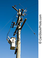 Power Lines - A wooden pole supporting a transformer and...