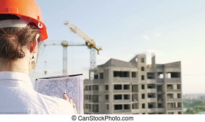 Architect looking on project on construction site