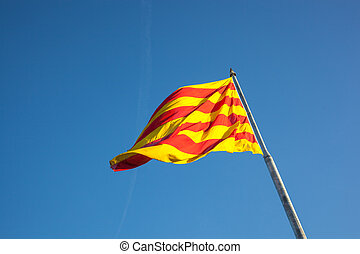Catalan flag fluttering in the wind Catalonia, Spain.
