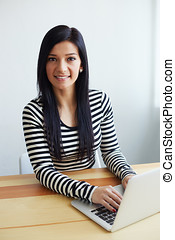 Young woman working in modern office on computer