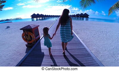 Little girl and young mom during beach vacation - Little...