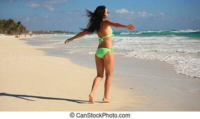 Young beautiful woman enjoying beach tropical vacation -...