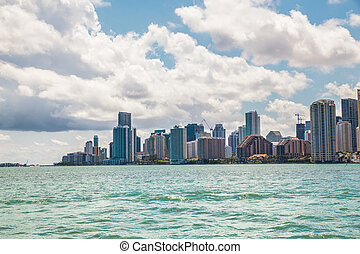 Miami Florida skyline across bay on a sunny day with clouds...