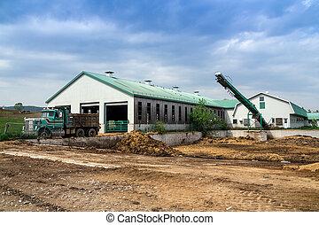Dairy farm building exterior manure pit