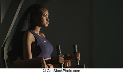 Young gorgeous african american woman working out  at the gym