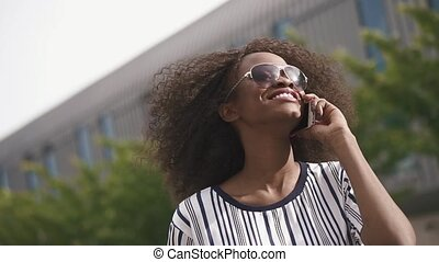 Charming young african american business woman in sunglasses...