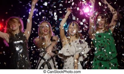 Girls dancing, throwing confetti, blowing kisses Dynamic...