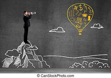 success concept - businessman looking on balloon with...