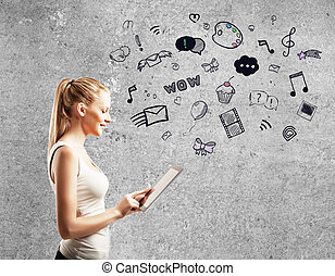 woman using touch pad - young woman standing against...