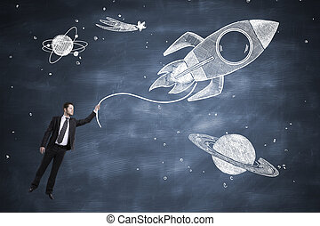 rocket and businessman - drawing rocket with businessman on...