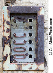Old doorbells - Detail of the old and damaged doorbells