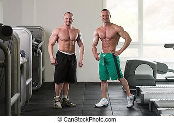 Musker, gymnastiksal, män, två, muskulös, böja