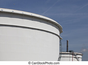 white oil tanks in the harbour of rotterdam