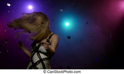 Blond girl dancing movement of head and hands Close-up -...