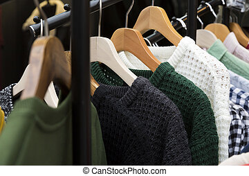 Winter sweater on clothes rack