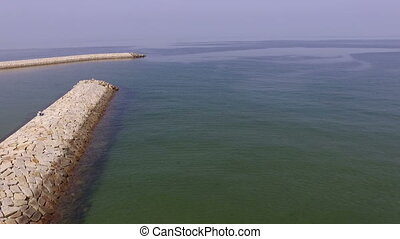 breakwater of stone - aerial view of breakwater of stone...