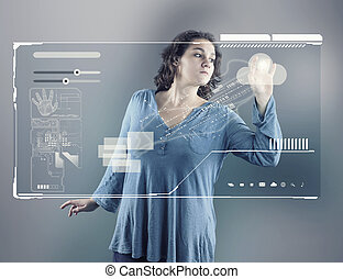 Young girl using virtual screen; checking database and...