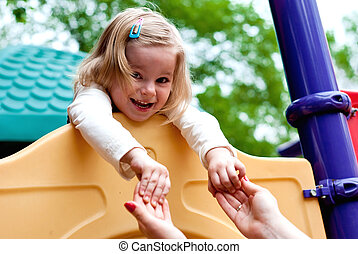 Girl in the playground - Smiling girl in the playground ....