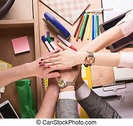 Business people showing teamwork in office - Top view of...