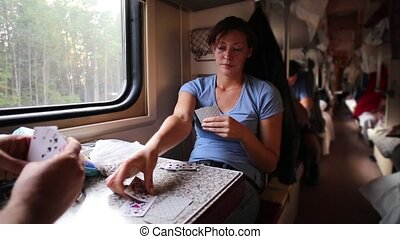 Man And Woman Plaing Cards In Train - Woman And man Plaing...