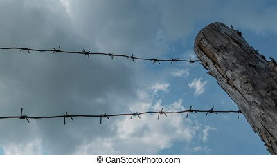 Barbed Wire And Clouds,Time Lapse