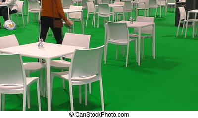 People in cafe with green floor