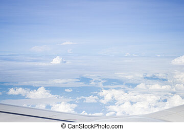 Cloudy sky view from airplane cabin window, stock photo