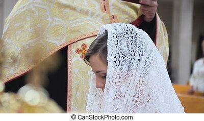 Bride in a scarf in the church HD