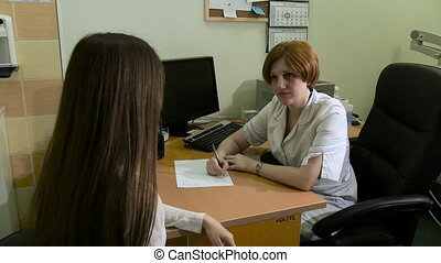 The girl on reception at the doctor. - The girl on reception...
