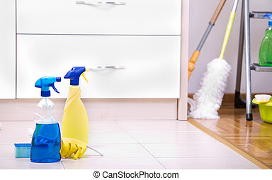 Two spray bottles on kitchen floor - Cleaning supplies and...