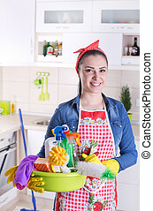 Happy cleaning lady in kitchen - Happy beautiful young woman...