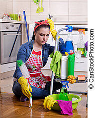 Tired and unhappy cleaning lady - Tired beautiful young...