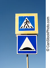 Pedestrian Crossing and Speed Hump - Road safety sign of a...