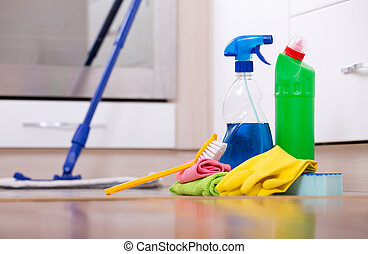 House cleaning concept - Cleaning supplies and equipment on...